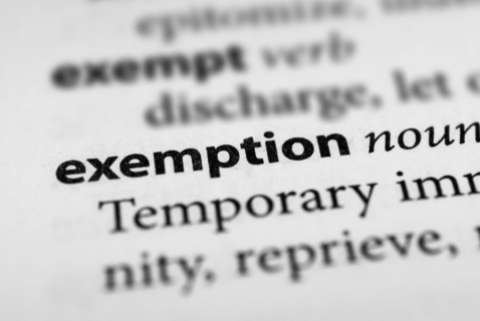 "Close up image of the word ""exemption"" in a dictionary"