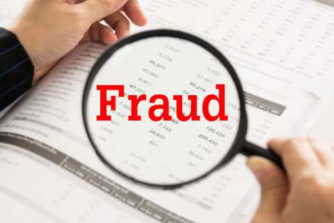 "A magnifying glass overs over a spreadsheet, with the word ""Fraud"" superimposed in red text"