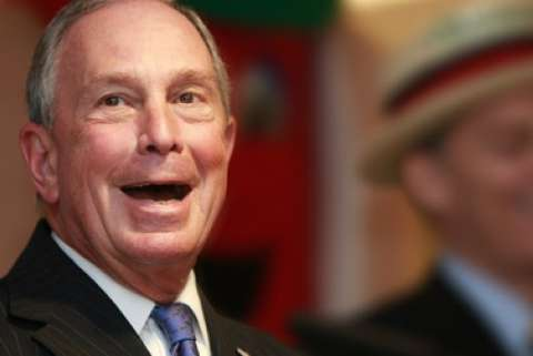 Former New York City mayor Michael Bloomberg smiles with his mouth open wide