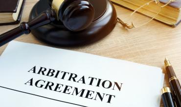 A gavel and an arbitration agreement