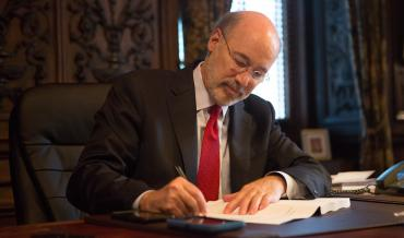 Pennsylvania Governor Tom Wolf signing a bill into law