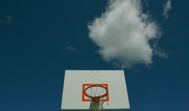 Basketball hoop and blue sky