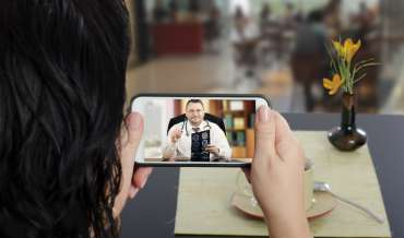 A woman consulting a doctor over videochat on a smartphone