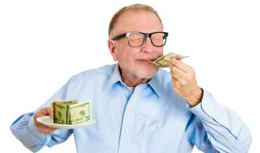 old man smelling money