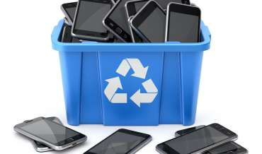smart phones in a blue recycling bin