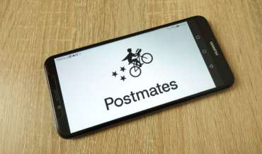 A smartphone displaying the Postmates logo
