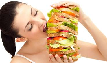 woman eating gigantic sandwich