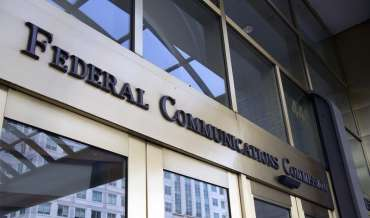 The sign over the door at the entrance to the FCC headquarters