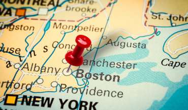 A map of Massachusetts with a red pushpin in Boston