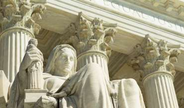A statue in front of the United States Supreme Court