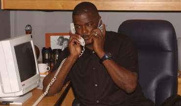 Joe Dumars listen to two phones at the same time